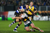 Rhys Priestland of Bath Rugby is tackled by Kieran Brookes of Northampton Saints. Aviva Premiership match, between Bath Rugby and Northampton Saints on February 10, 2017 at the Recreation Ground in Bath, England. Photo by: Patrick Khachfe / Onside Images