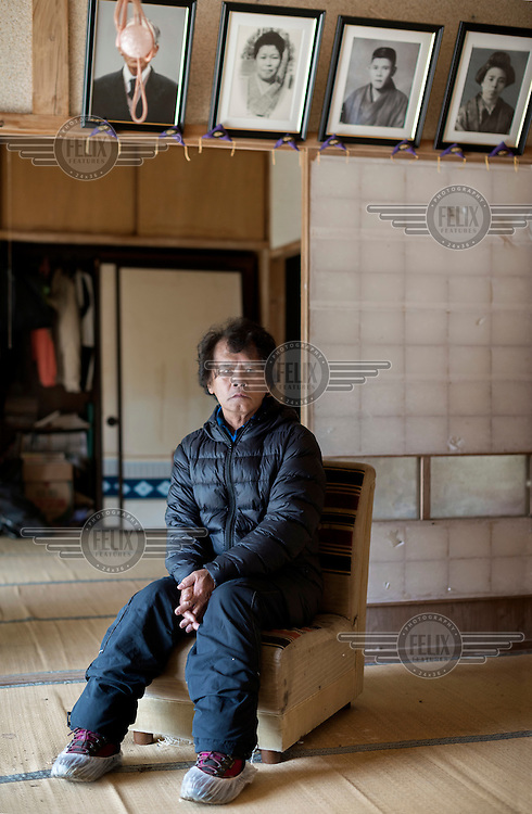 Toru Anzai sits in his abandoned house in the village of Itate. He was a rice farmer but his fields have been contaminated following the 2011 Fukushima Daiichi nuclear disaster and he has not been able to work any of his land since.  On 11 March 2011 a magnitude 9 earthquake struck 130 km off the coast of Northern Japan causing a massive tsunami that swept across the coast of Northern Honshu damaging the Fukushima Daiichi nuclear power plant and triggering the worst nuclear accident since Chernobyl. The plant was shut down and a 20 km evacuation zone around the plant was declared by the government. Levels of radiation in the evacuation zone remain high. .