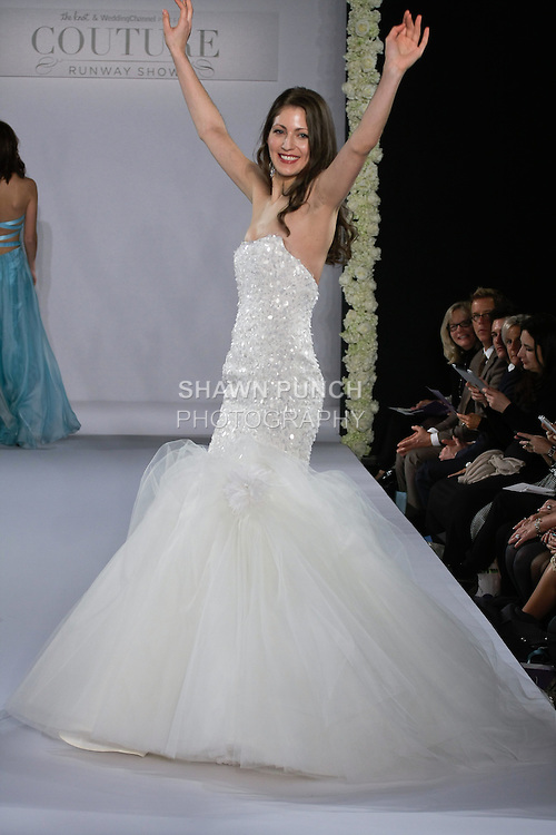 Model walks runway in a Contessa wedding dress by Victoria McMillan, from the Victoria Nicole bridal collection, at the Couture Runway Show, during New York Bridal Fashion Week at The Hilton Hotel, October 13, 2012.