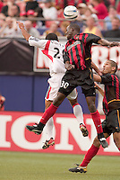 The MetroStars' Tenywa Bonseu goes up for a header against D.C. United's Ronald Cerritos as Craig Ziadie watches. D. C. United was defeated by the NY/NJ MetroStars 3 to 2 during the MetroStars home opener at Giant's Stadium, East Rutherford, NJ, on April 17, 2004.