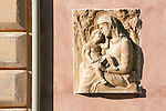 Madonna and child, small sculpture on a wall in Ravenna, Italy.