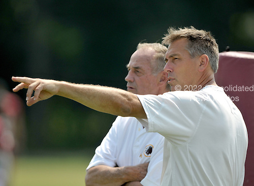 Ashburn, VA - August 4, 2009 -- Washington Redskins head coach Jim Zorn, right, points out something in the defense to Hall of Fame linebacker Sam Huff, left, during today's afternoon session of training camp for the 2009 season at Redskins Park in Ashburn Virginia on Monday, August 4, 2009..Credit: Ron Sachs / CNP