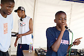 Rap performance by members of Fisherton Estate Youth Club at Church Street Summer Festival 2005, Paddington, London.