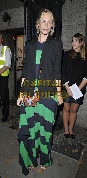 LONDON, ENGLAND - SEPTEMBER 14: Poppy Delevingne attends the Jonathan Saunders S/S15 catwalk show, LFW Day 3, British Museum, Great Russell St., on Sunday September 14, 2014 in London, England, UK. <br /> CAP/CAN<br /> &copy;Can Nguyen/Capital Pictures