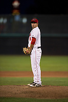 Orem Owlz relief pitcher Johnny Morell (18) gets ready to deliver a pitch during a Pioneer League game against the Ogden Raptors at Home of the OWLZ on August 24, 2018 in Orem, Utah. The Ogden Raptors defeated the Orem Owlz by a score of 13-5. (Zachary Lucy/Four Seam Images)