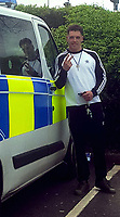"Pictured: Kyle McDonagh gives the fingers while standing next to a police van<br /> Re: A burglar was caught after his fingerprints were found on a biscuit tin that had been dumped in a garden.<br /> He then went on the run and posted pictures and messages to police on his Facebook page.<br /> The tin was found in the garden of a house that had been burgled in the Splott area of Cardiff.<br /> A laptop and a bike were also taken in the burglary at the house on Gwendoline Street in April.<br /> Kyle McDonagh's fingerprints were identified following forensic tests, and a search for him was launched.<br /> The 28-year-old evaded officers for a number of weeks, and even tried to goad police with photographs that he posted using social media.<br /> It is understood he took a picture next to a police van and posted it.<br /> And he also wrote: ""Another chase at least it's keeping me fit in suppose."""