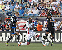 New England Revolution forward Saer Sene (39) efforts thwarted by defenders, San Jose Earthquakes forward Adam Jahn (14) and San Jose Earthquakes midfielder Shea Salinas (6). In a Major League Soccer (MLS) match, the New England Revolution (white) defeated San Jose Earthquakes (black), 2-0, at Gillette Stadium on July 6, 2013.