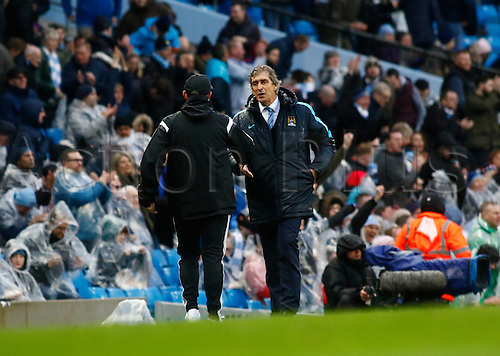 09.04.2016. The Emirates Stadium, Manchester, England. Barclays Premier League. Manchester City versus West Bromwich Albion. A soked Manchester City manager Manuel Pellegrini shakes hands with WBA boss Tony Pulis after City run out 2-1 winners.