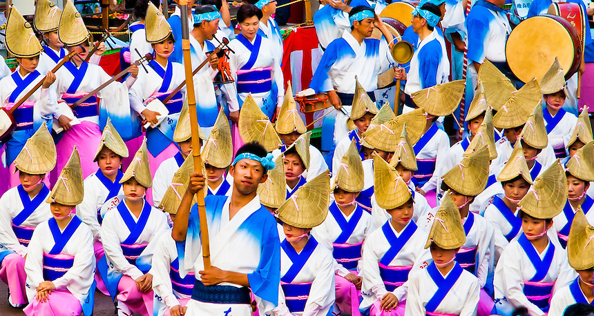 Tokashima`s famous Awaodori festival dancers get ready to perform in their traditional brightly colored costumes.