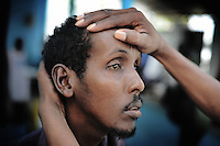 Mogadishu/Somalia 2012 - A patient with mental  disorder  is being examined by Dr. Habeb that runs three clinics in the Somali capital, Mogadishu.