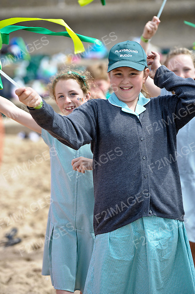 School children celebrate the Olympic Torch passing through Sefton Merseyside. 1.6.10