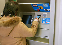 Illustration Photo<br /> <br /> A woman  use an Automated Bank machine,in Montreal, CANADA, <br /> <br /> (Mandatory Credit: Photo by Sevy - Images Distribution (©) Copyright 2002 by Sevy<br /> <br /> NOTE :  D-1 H original JPEG, saved as Adobe 1998 RGB.