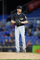 Akron RubberDucks relief pitcher Robbie Aviles (11) gets ready to deliver a pitch during a game against the Binghamton Rumble Ponies on May 12, 2017 at NYSEG Stadium in Binghamton, New York.  Akron defeated Binghamton 5-1.  (Mike Janes/Four Seam Images)