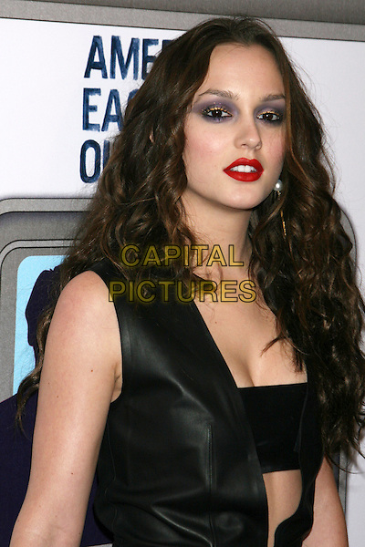 LEIGHTON MEESTER.Preview Party for the Grand Opening of the American Eagle Outfitters Flagship Store in Times Square, New York, NY, USA..November 17th, 2009.half length black leather dress red lipstick plunging neckline bra purple eyeshadow smokey eyes make-up.CAP/LNC/TOM.©TOM/LNC/Capital Pictures.