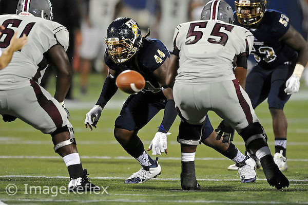 19 September 2015:  FIU defensive tackle Darrian Dyson (44) rushes the quarterback as the FIU Golden Panthers defeated the North Carolina Central University Eagles, 39-14, at FIU Stadium in Miami, Florida.