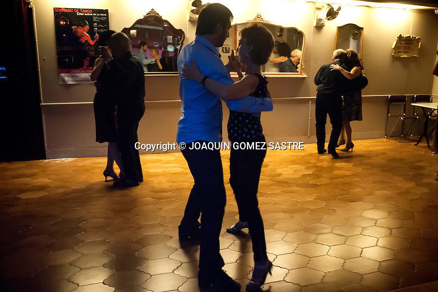 Couples enjoy the warm atmosphere and the tangos at the headquarters of the rock tango friends on Saturday night milongas organized dance<br />  PHOTO &copy; JOAQUIN GOMEZ  SASTRE