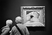 France. Ile-de-france Department. Paris. Orsay Museum. Two elderly women with grey hair look at the painting, L'Origine du Monde, by Gustave Courbet. L'Origine du monde (The Origin of the World) is an oil-on-canvas painted by French artist Gustave Courbet in 1866. It is a close-up view of the genitals and abdomen of a naked woman, lying on a bed with legs spread. The framing of the nude body, with head, arms and lower legs outside of view, emphasizes the eroticism of the work. Eroticism is generally understood to refer to a state of sexual arousal or anticipation of such an insistent sexual impulse, desire, or pattern of thoughts, as well as a philosophical contemplation concerning the aesthetics of sexual desire, sensuality and romantic love. 04.11.09  © 2009 Didier Ruef