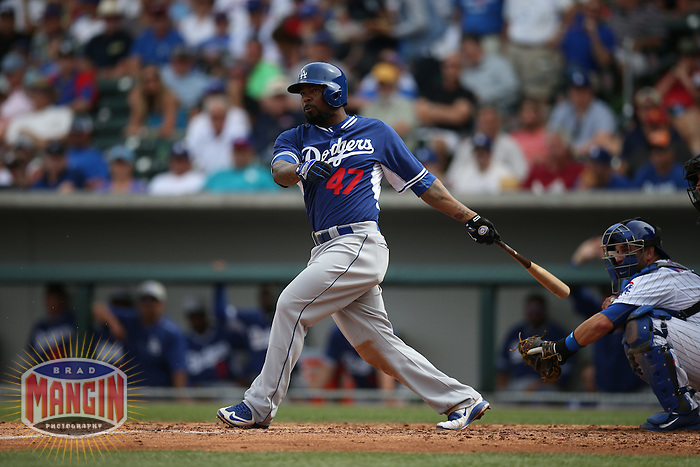 MESA, AZ - MARCH 11:  Howie Kendrick of the Los Angeles Dodgers bats against the Chicago Cubs during a spring training game at Sloan Park on March 11, 2015 in Mesa, Arizona. (Photo by Brad Mangin)