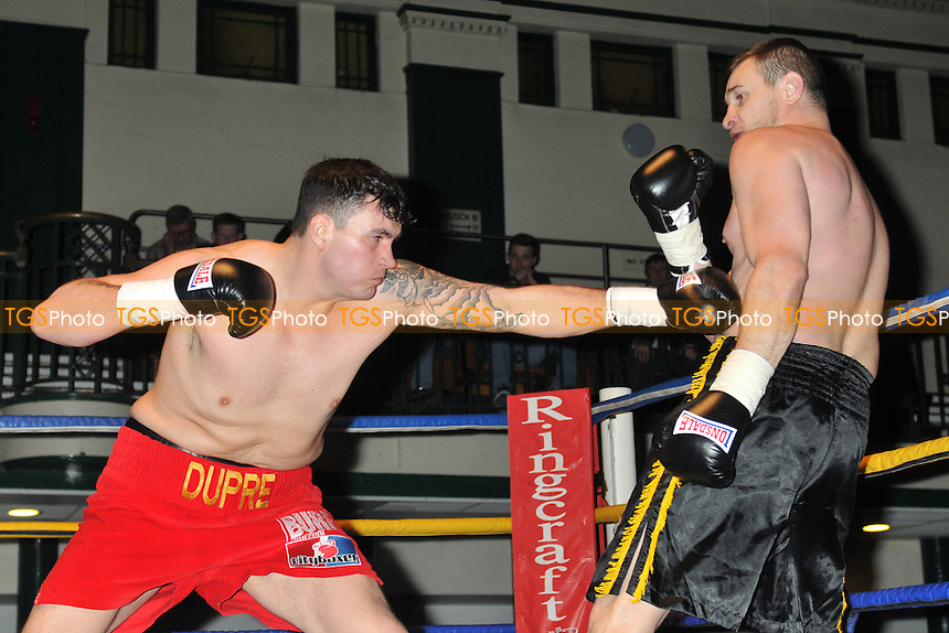 Robin Dupre (red shorts) defeats Jiri Svacina - Boxing at York Hall, Bethnal Green, London - 13/03/15 - MANDATORY CREDIT: Philip Sharkey/TGSPHOTO - Self billing applies where appropriate - contact@tgsphoto.co.uk - NO UNPAID USE