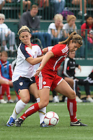 USWNT's Amy Rodriguez (8), left and Canada's Emily Zurrer battle for the ball. The U.S. Women's National Team defeated Canada 1-0 in a friendly match at Marina Auto Stadium in Rochester, NY on July 19, 2009. Abby Wambach of the USWNT scored her 100th career goal in the second half..