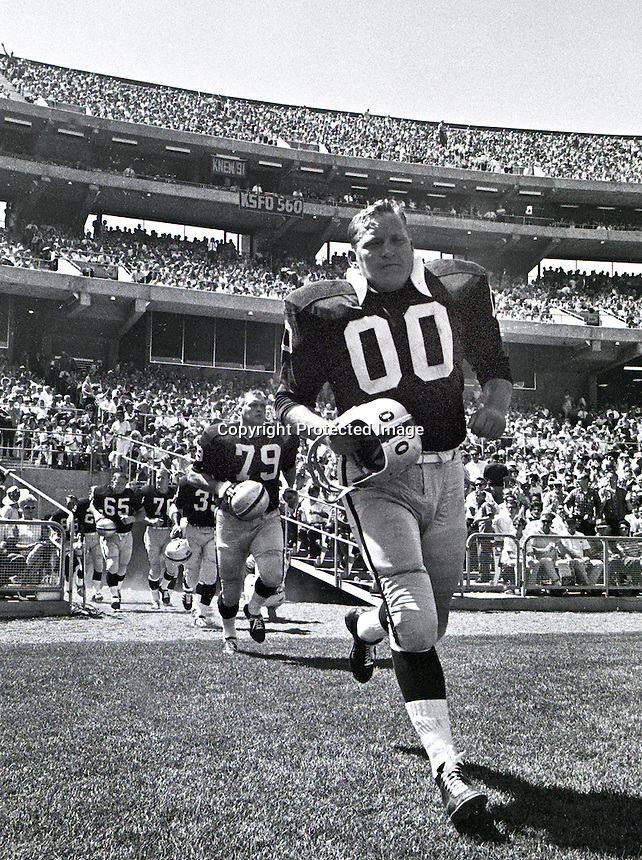 Center Jim Otto leads the Oakland Raiders on the field at the Oakland Alameda County Coliseum. (1967 photo by Ron Riesterer)