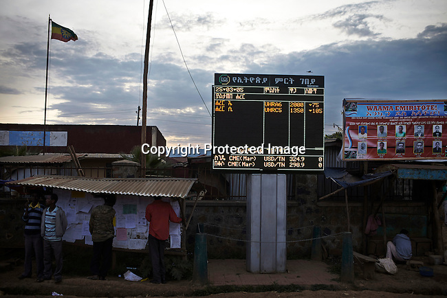 BONGA, ETHIOPIA:  A digital board display coffee and other commodity prices in the center of the village on December 4, 2012 Bonga, Ethiopia. This Kaffa region is known for its coffee production, wild coffee grown in high altitudes. This region is the original home of the coffee plant, coffee Arabica which grows in the forest of the highlands. The red berries are the main source of income in the area. Children and cattle also drink coffee. (Photo by: Per-Anders Pettersson)