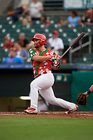 "Palm Beach Cardinals first baseman Chris Chinea (5) follows through on a swing during a game against the Charlotte Stone Crabs on July 22, 2017 at Roger Dean Stadium in Palm Beach, Florida.  The Cardinals wore special ""Ugly Sweater"" jerseys for Christmas in July.  Charlotte defeated Palm Beach 5-2.  (Mike Janes/Four Seam Images)"