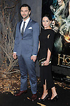 """Aidan Turner and wife at the Los Angeles premiere of """"The Hobbit: The Desolation Of Smaug"""" held at the Dolby Theater December 2, 2013."""
