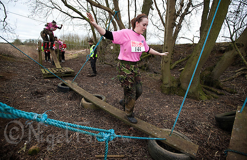 06 FEB 2011 - SIBBERTOFT, GBR - Jodi Johnson tackles an obstacle during the Avalanche Adventure Run (PHOTO (C) NIGEL FARROW)