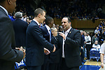 DURHAM, NC - JANUARY 29: Notre Dame head coach Mike Brey (right) with Duke assistant coach Jon Scheyer (left). The Duke University Blue Devils hosted the University of Notre Dame Fighting Irish on January 29, 2018 at Cameron Indoor Stadium in Durham, NC in a Division I men's college basketball game. Duke won the game 88-66.