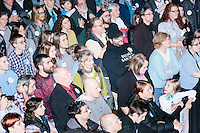 People watch as Vermont senator and Democratic presidential candidate Bernie Sanders speaks at a town hall at the Rochester Opera House in Rochester, New Hampshire, on Thurs., Feb. 4, 2016. Press and attendee turnout was low for the event because of scheduling issues. The rally had been scheduled for the previous day, postponed, and then rescheduled just a few hours before the event took place. Later that night, Sanders took part in an MSNBC-sponsored debate with Hillary Rodham Clinton.