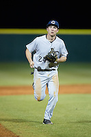 Catawba Indians second baseman Kyle Smith (24) jogs off the field between innings of the game against the Belmont Abbey Crusaders at Abbey Yard on February 7, 2017 in Belmont, North Carolina.  The Crusaders defeated the Indians 12-9.  (Brian Westerholt/Four Seam Images)