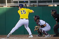 Michigan Wolverines first baseman Kendall Patrick (15) at bat during the NCAA season opening baseball game against the Texas State Bobcats on February 14, 2014 at Bobcat Ballpark in San Marcos, Texas. Texas State defeated Michigan 8-7 in 10 innings. (Andrew Woolley/Four Seam Images)