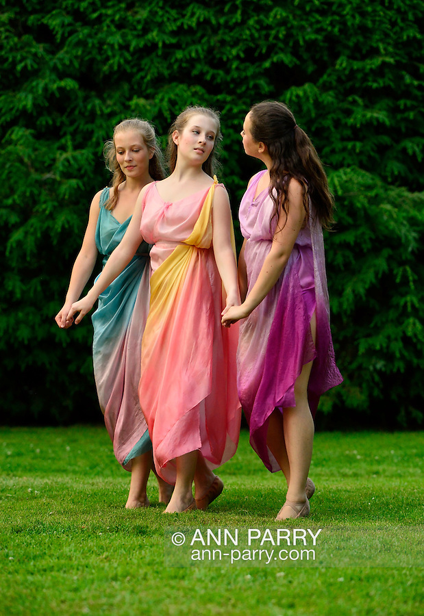 Old Westbury, New York, U.S. 22nd June 2013. Dances by Lori Belilove &amp; The Isadora Duncan Dance Company, with appearances by the Beliloveables, are performed by dancers at the Midsummer Night event at Old Westbury Gardens, throughout the illuminated grounds of the historic Long Island Gold Coast estate.<br /> The Three Graces, or Three Charities, of Greek mythology were Aglaia, Euphrosyne, and Thalia - goddesses of beauty, joy, harmony, pleasure, grace, festivity, adornment, dance, and song. Daughters of Zeus and sea-nymph Eurynome, they were also the attendants, or handmaidens, of Aphrodite and Hera and protectors of vegetation.