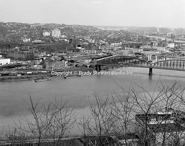 Pittsburgh PA:  View of Pittsburgh's north side - 1962.  View includes the Manchester Bridge, warehouses, Clark Candies factory and Allegheny General Hospital in the background.
