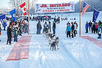 Colby Spears leaves the start line at Knik during the start of the Junior Iditarod on Saturday February 25, 2017. <br /> <br /> <br /> Photo by Jeff Schultz/SchultzPhoto.com  (C) 2017  ALL RIGHTS RESVERVED