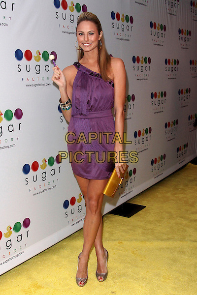 STACY KEIBLER.Mel B's Sugar Factory Couture Lollipop Series Launch Party at Guys and Dolls Lounge, West Hollywood, California, USA. .January 19th, 2010 .full length purple bracelets dress sweet candy gold clutch bag .CAP/ADM/TC.©T. Conrad/AdMedia/Capital Pictures.