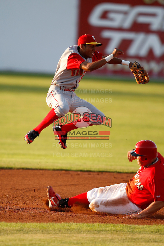 August 6, 2009:  Second Baseman Luis Nieves of the Brooklyn Cyclones jumps over Matthew Adams sliding in during a game at Dwyer Stadium in Batavia, NY.  The Cyclones are the Short-Season Class-A affiliate of the New York Mets.  Photo By Mike Janes/Four Seam Images