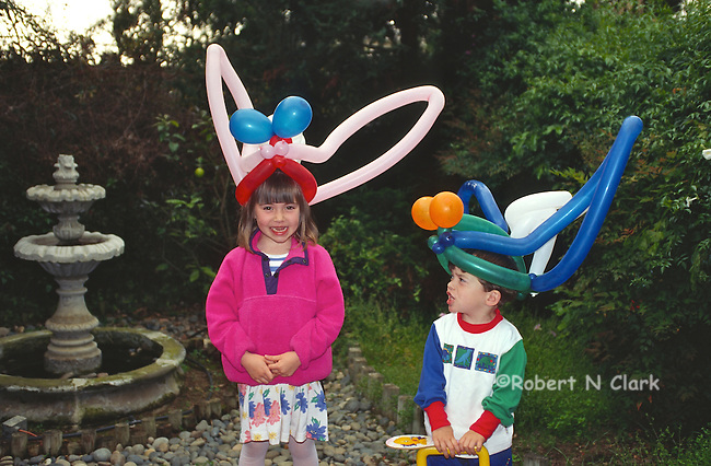 Boy and girl with balloon hats