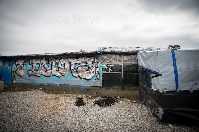 """Restaurant: """"3 Idiots"""".<br /> <br /> Calais Jungle Camp.<br /> <br /> Under the Sky of Calais & Dunkirk. Two Camps, Two Sides of the Same Coin: Not 'migrants', Not 'refugees', just Humans.<br /> <br /> France, 24-30/03/2016. Documenting (and following) Zekra and her experience in the two French camps at the gate of the United Kingdom: Calais' """"Jungle"""" and Dunkirk's """"Grande-Synthe"""". Zekra lives in London but she is originally from Basra in Iraq. Zekra and her family had to flee Kuwait - where they moved for working reason - due to the """"Gulf War"""", and to the Western Countries' will to """"export Democracy in Iraq"""". Zekra is a self-motivated volunteer and founder of """"Happy Ravers"""", a group of people (not a NGO or a charity) linked to each other because of their love for rave parties but also men and women who meet up every week to help homeless people and other people in need in Central London. (Here there are some of the stories I covered about Zekra and """"Happy Ravers"""": http://bit.ly/1XVj1Cg & http://bit.ly/24kcGQz & http://bit.ly/1TY0dPO). Zekra worked as an English teacher in the adult school at Dunkirk's """"Grande-Synthe"""" camp and as a cultural mediator and Arabic translator for two medic teams in Calais' """"Jungle"""". Please read her story at the beginning of this reportage."""
