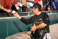 May 3, 2010:  Catcher Corky Miller of the Louisville Bats signs autographs before a game vs. the Buffalo Bisons at Coca-Cola Field in Buffalo, NY.   Louisville defeated Buffalo by the score of 20-7.  Photo By Mike Janes/Four Seam Images