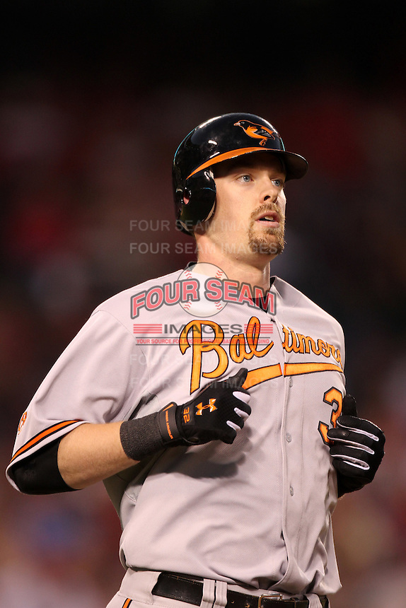 Baltimore Orioles catcher Matt Wieters #32 runs to first base against the Los Angeles Angels at Angel Stadium on August 20, 2011 in Anaheim,California. Los Angeles defeated Baltimore 9-8.(Larry Goren/Four Seam Images)