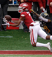 Arkansas Democrat-Gazette/THOMAS METTHE -- 11/29/2019 --<br /> Arkansas wide receiver Trey Knox (7) pulls in a touchdown pass while defended by Missouri defensive back Christian Holmes (21) during the first quarter of the Razorbacks' 24-14 loss to Missouri on Friday, Nov. 29, 2019, at War Memorial Stadium in Little Rock.