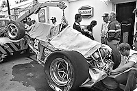 INDIANAPOLIS, IN - MAY 27: The Parnelli VPJ6C/Cosworth TC driven by Danny Ongais is returned to the garage area after a crash during practice for the Indy 500 at the Indianapolis Motor Speedway in Indianapolis, Indiana, on May 27, 1979.