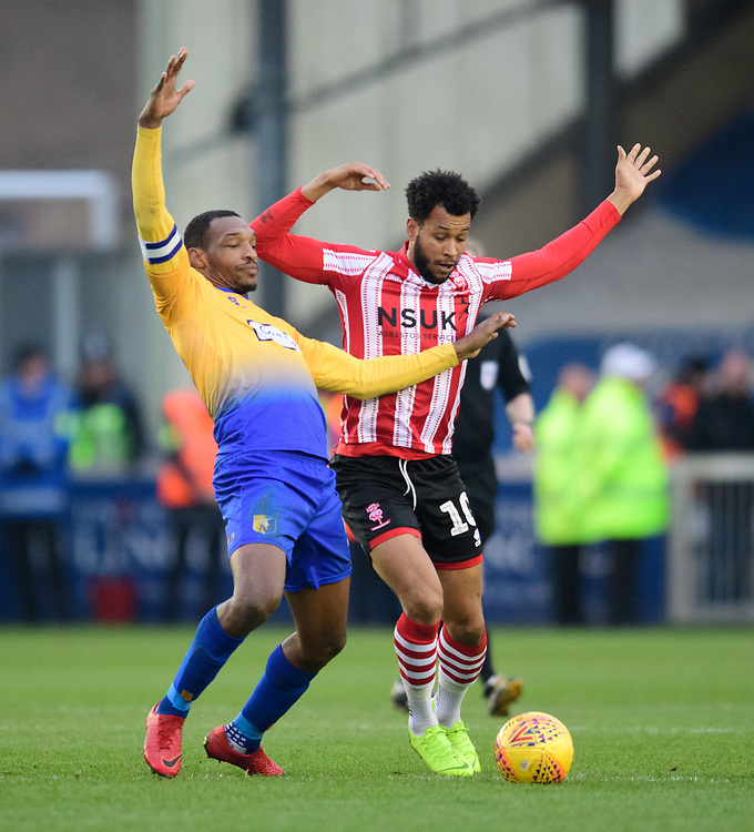 Lincoln City's Matt Green vies for possession with Mansfield Town's Krystian Pearce<br /> <br /> Photographer Chris Vaughan/CameraSport<br /> <br /> The EFL Sky Bet League Two - Lincoln City v Mansfield Town - Saturday 24th November 2018 - Sincil Bank - Lincoln<br /> <br /> World Copyright © 2018 CameraSport. All rights reserved. 43 Linden Ave. Countesthorpe. Leicester. England. LE8 5PG - Tel: +44 (0) 116 277 4147 - admin@camerasport.com - www.camerasport.com