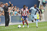 Miller Bolanos (10) midfield Chivas USA , Mechack Jerome (24) defender Sporting KC ..Sporting Kansas City defeated Chivas USA 4-0 at Sporting Park, Kansas City, Kansas.