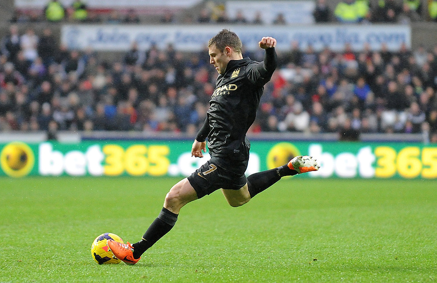 Manchester City's James Milner lines up a shot <br /> <br /> Photo by Ian Cook/CameraSport<br /> <br /> Football - Barclays Premiership - Swansea City v Manchester City - Wednesday 1st January 2014 - Liberty Stadium - Swansea<br /> <br /> &copy; CameraSport - 43 Linden Ave. Countesthorpe. Leicester. England. LE8 5PG - Tel: +44 (0) 116 277 4147 - admin@camerasport.com - www.camerasport.com