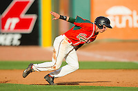 Cameron Flynn (11) of the Greensboro Grasshoppers dives back to first base against the Delmarva Shorebirds at NewBridge Bank Park on May 26, 2013 in Greensboro, North Carolina.  The Grasshoppers defeated the Shorebirds 11-2.  (Brian Westerholt/Four Seam Images)