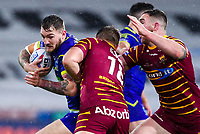 Picture by Alex Whitehead/SWpix.com - 08/02/2018 - Rugby League - Betfred Super League - Huddersfield Giants v Warrington Wolves - John Smith's Stadium, Huddersfield, England - Warrington's Daryl Clark is tackled by Huddersfield's Paul Clough.