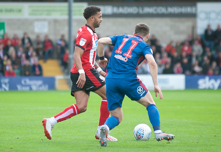 Lincoln City's Bruno Andrade vies for possession with Sunderland's Lynden Gooch<br /> <br /> Photographer Andrew Vaughan/CameraSport<br /> <br /> The EFL Sky Bet League One - Lincoln City v Sunderland - Saturday 5th October 2019 - Sincil Bank - Lincoln<br /> <br /> World Copyright © 2019 CameraSport. All rights reserved. 43 Linden Ave. Countesthorpe. Leicester. England. LE8 5PG - Tel: +44 (0) 116 277 4147 - admin@camerasport.com - www.camerasport.com